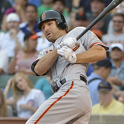 Called up from Triple-A Saturday, Xavier Nady delivers a three-run double for the Giants in his first MLB game of the year. (Getty Images)