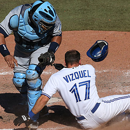 Jose Molina tags out Omar Vizquel for the final out in the Rays' one-run victory over the Blue Jays.  (Getty Images)