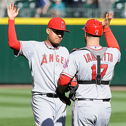 Reliever Ernesto Frieri and Chris Iannetta celebrate after the Angels saddle Felix Hernandez with his first loss since June 12. (US Presswire)
