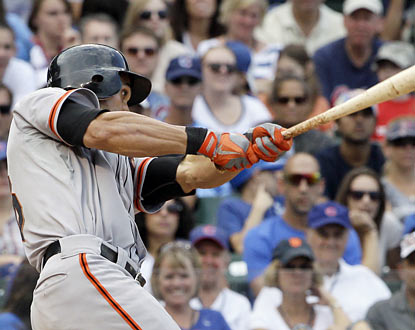 The Giants' Angel Pagan delivers in the ninth inning with a tiebreaking RBI single against the Cubs.  (AP)