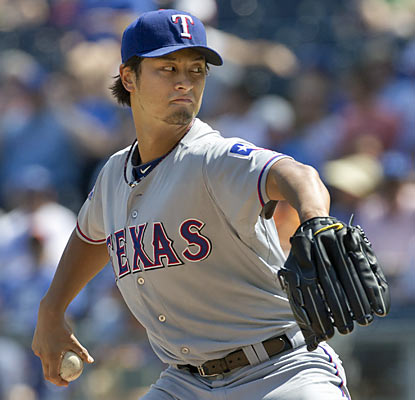 Rookie Yu Darvish pitches seven strong innings and racks up his 14th win of the season. (AP)
