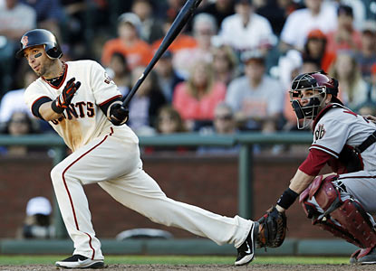 Marco Scutaro drives in the winning run in the 10th inning off D-Backs closer J.J. Putz. (AP)