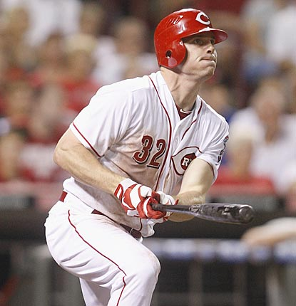 Jay Bruce follows the flight of his two-run blast in the sixth inning that puts first-place Cincinnati ahead to stay.  (Getty Images)