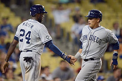 Cameron Maybin and Everth Cabrera come in to score on Logan Forsythe's two-run single in the 11th inning. (Getty Images)