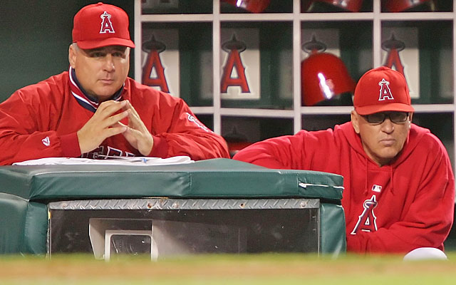 Mike Scioscia managed the Angels to a World Series title in 2002 with Joe Maddon at his side. (Getty Images)