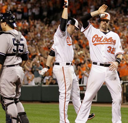 Mark Reynolds (middle) celebrates his two-run shot in the eighth inning with Matt Wieters.  (Getty Images)