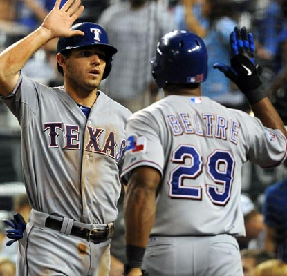 Adrian Beltre is glad to see Ian Kinsler score the game-winning run in the 10th inning for Texas.  (US Presswire)