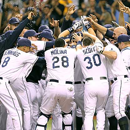 Ben Zobrist's home run in the bottom of the 11th inning lifts the Rays over the Rangers for their fifth win in six games. (US Presswire)