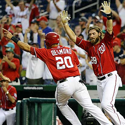 The Nats' Jayson Werth (right) homers in the ninth to tie the game and Corey Brown wins it in the 10th with an RBI single.  (US Presswire)