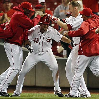 The Reds can finally celebrate after prevailing through their longest game of the season.  (US Presswire)