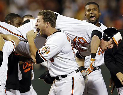 It's only fair the Orioles carry off Nate McLouth moments after he walks off against the Rays in the ninth. (AP)
