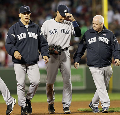 Derek Jeter limps off the field in the eighth after coming up lame while running to first base. (AP)