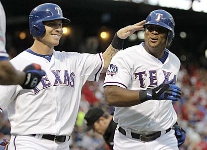 Josh Hamilton congratulates Adrian Beltre on his home run in the first inning, which pushes Texas' lead to 3-0.  (AP)