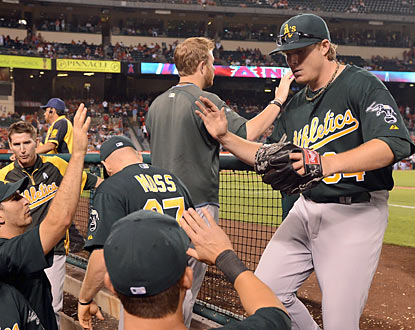 The A's congratulate A.J. Griffin, who exits after eight shutout innings. The rookie improves to 6-0 on his young career. (Getty Images)