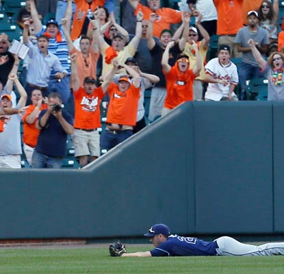 Matt Joyce can't quite make the play on Manny Machado's bloop single, to the delight of the Orioles faithful.  (Getty Images)