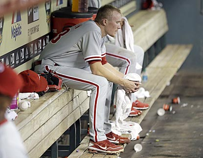 Phillies reliever Jacob Diekman gathers his thoughts after giving up the game-deciding hits in the eighth inning.  (AP)
