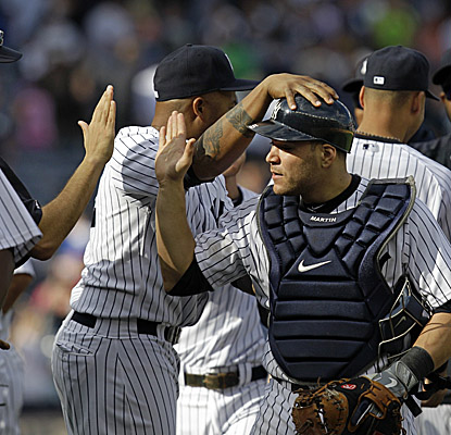 Catcher Russell Martin gets the Yankees out to an early lead vs. the Rays, hitting a three-run HR in the third inning. (AP)