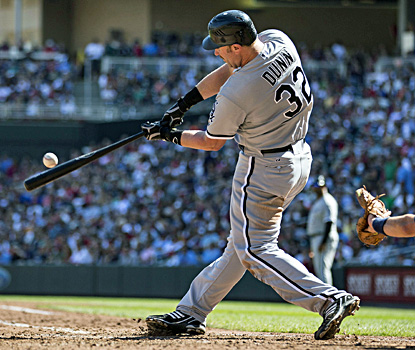 Adam Dunn hits a double in the seventh inning against the Twins at Target Field. (US Presswire)