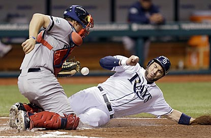 Luke Scott slides in safely to give Tampa Bay a 1-0 lead in the fifth, but it's all downhill for the Rays from there.  (AP)