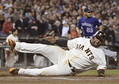 Pablo Sandoval scores what proves to be the deciding run on Hunter Pence's single in the bottom of the sixth inning.  (Getty Images)