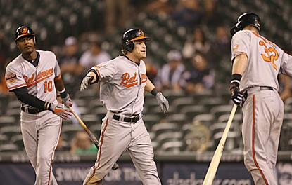 Nate McLouth (center) celebrates after scoring the go-ahead run in the 18th inning, which he began with a leadoff walk.  (Getty Images)