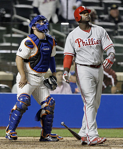 Ryan Howard and catcher Kelly Shoppach both watch Howard's 11th home run of the season sail over the wall in the ninth. (AP)