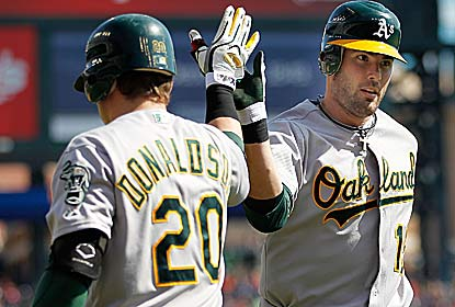 Seth Smith homers, doubles and drives in four runs to help the A's avoid getting swept in Detroit. (Getty Images)