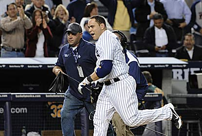 Russell Martin sends the crowd home happy with his leadoff 10th-inning homer for the Yanks, who remain atop the AL East. (AP)