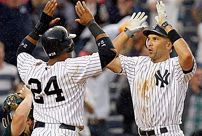 Raul Ibanez (right) hits his second of two homers -- a game-tying shot -- in the 13th for the Yanks, who win on an error. (Getty Images)
