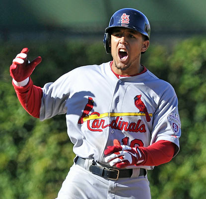 Jon Jay doubles in the winning run in the 10th to help the Cardinals rebound from an extra-inning loss on Friday.  (AP)