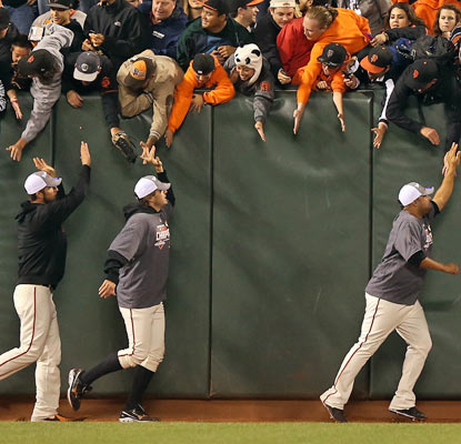 The Giants celebrate their second NL West pennant in three years with the home fans in San Francisco.  (Getty Images)