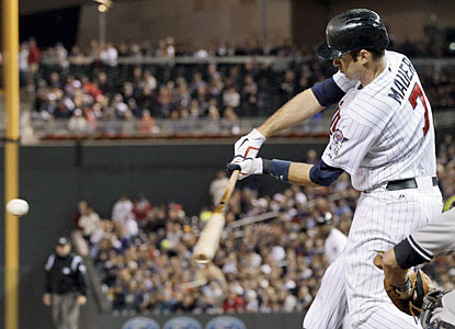 Joe Mauer finishes with three hits, including the go-ahead run in the seventh inning against the Yankees. (AP)