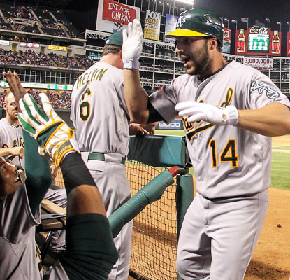 George Kottaras celebrates his tie-breaking home run in the 10th inning that lifts the A's over their division rivals.  (US Presswire)