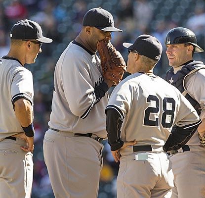 CC Sabathia gives manager Joe Girardi (28) eight strong innings, striking out 10, against the Twins.  (US Presswire)