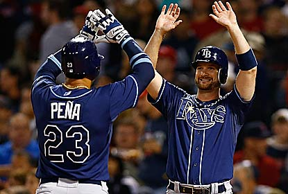 Carlos Pena and the Rays ruin Boston's home finale to stay 3 1/2 games back for a wild card. (Getty Images)