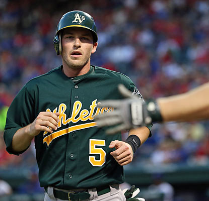 Stephen Drew finishes with four hits, drives in two runs and crosses the plate once to help the A's roll past the Rangers. (Getty Images)