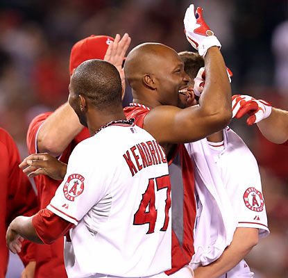 Teammates celebrate with Torii Hunter, who ends the game with a walk-off single in the ninth. (Getty Images)