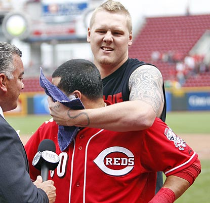 Dioner Navarro gets a shaving cream pie to the face from Reds starter Mat Latos after driving in the winning run.  (US Presswire)