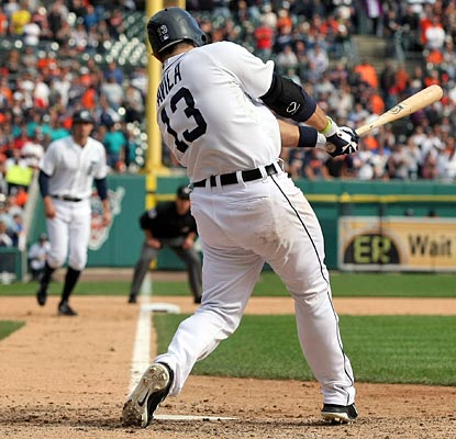 Alex Avila's fielders-choice grounder to first scores Don Kelly (background) to deliver the victory.  (Getty Images)