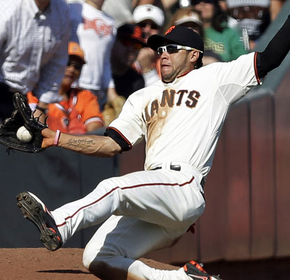 Gregor Blanco makes a sliding catch ad the Giants continue to roll toward the postseason.  (AP)