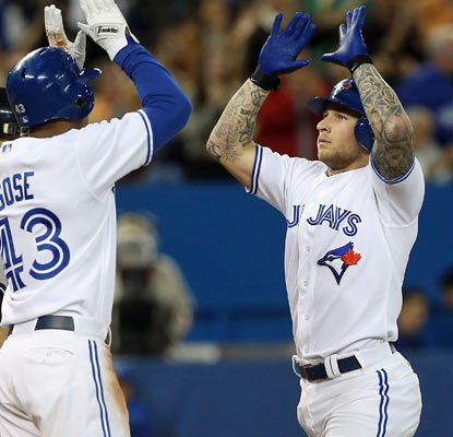 Brett Lawrie comes home on his two-run shot as the Blue Jays do their part to tighten the AL East race.  (US Presswire)