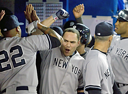 Russell Martin celebrates with Andruw Jones (left) after hitting a three-run home run during the sixth inning. (AP)