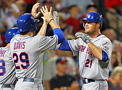 Lucas Duda (right) celebrates with Ike Davis (left) after hitting a three-run home run in the seventh inning. (AP)