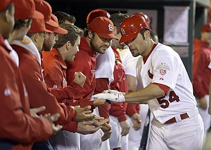 Cardinals pitcher Jaime Garcia goes down the reception line after helping his own cause with a solo home run.  (AP)