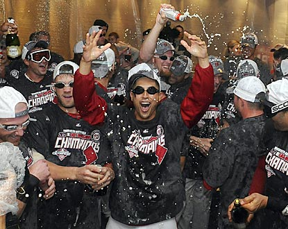 Gio Gonzalez (center) and Bryce Harper are among those celebrating the first division title in Expos/Nationals history.  (US Presswire)