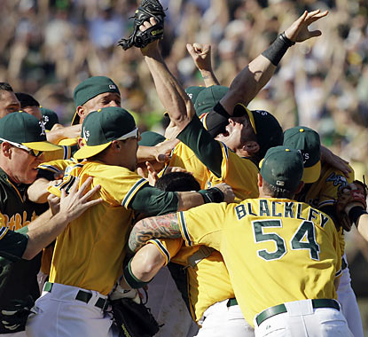 The Athletics celebrate winning the AL West after overcoming a four-run hole and a 13-game division deficit. (AP)