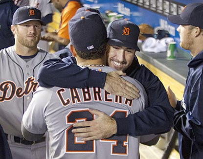 Justin Verlander embraces Miguel Cabrera after the star third baseman is pulled from the game and is assured of a Triple Crown. (AP)