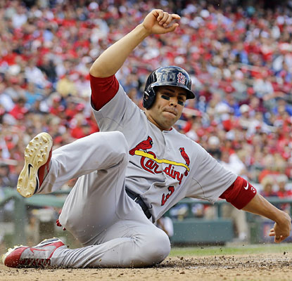 Carlos Beltran continues to excel in the postseason, going 2 for 4 in Game 3 and scoring the Cards' final run.  (AP)
