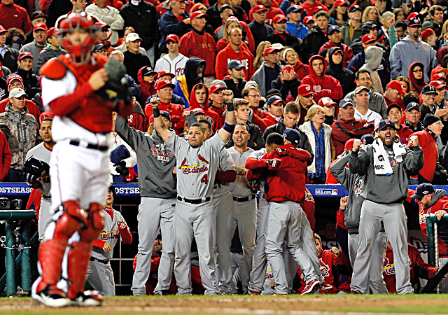 Yadier Molina and the Cardinals dugout celebrates after taking the lead in the ninth inning. (Getty Images)