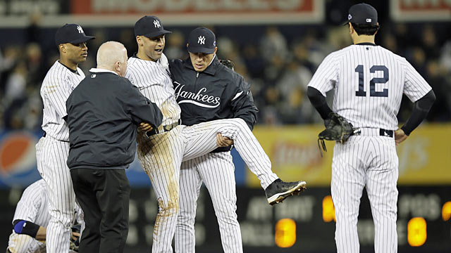 Girardi, who helps carry Derek Jeter off the field, says the Yanks 'have to find a way to move on.' (AP)